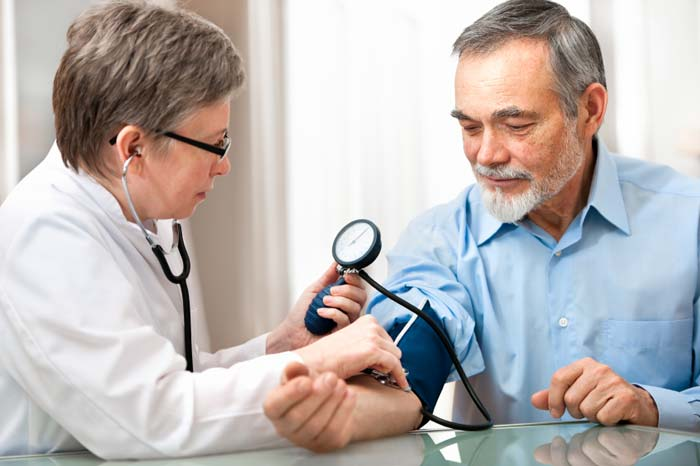 man checking blood pressure