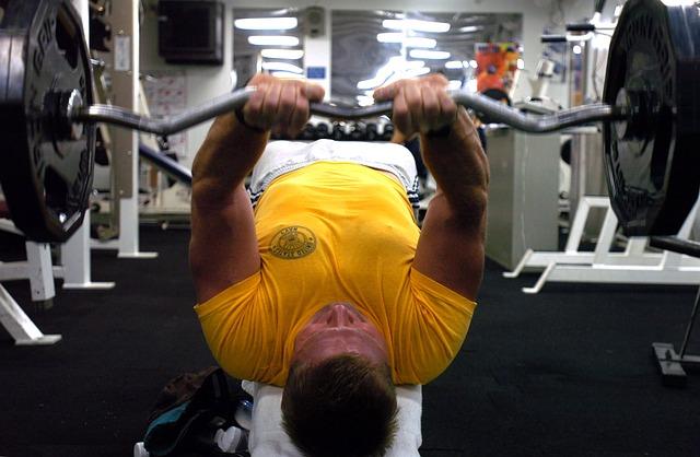 man doing bench press exercise