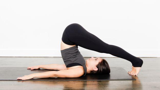 Halasana yoga pose (Plow Pose)