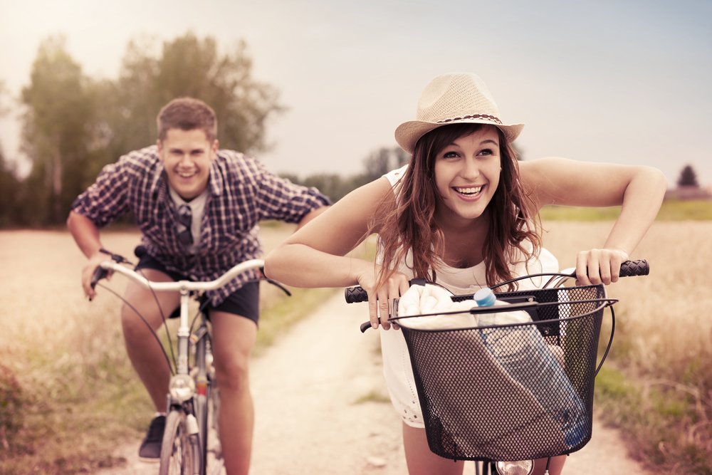 man and woman biking