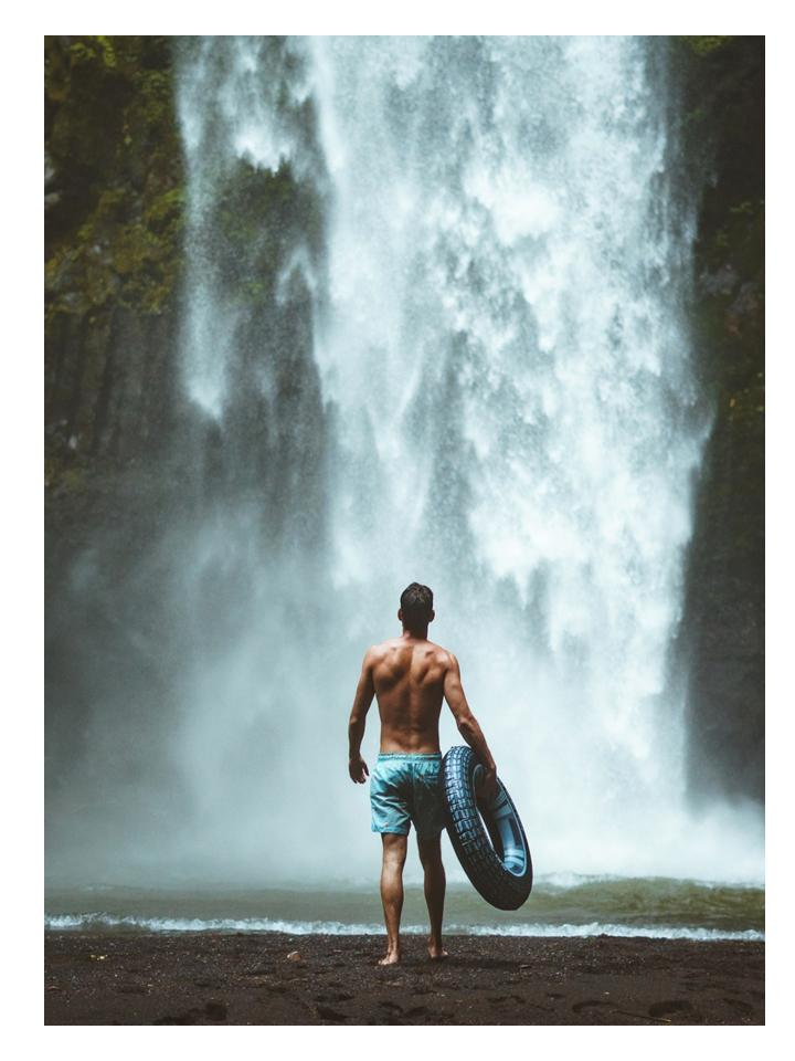 man in a waterfall