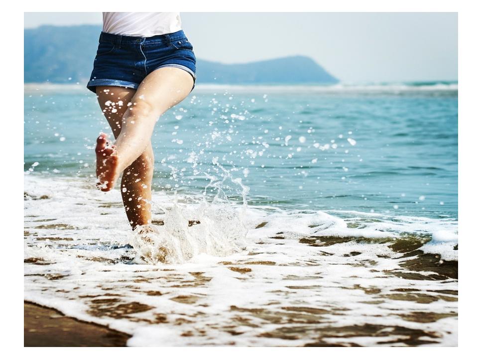 splashing in the ocean