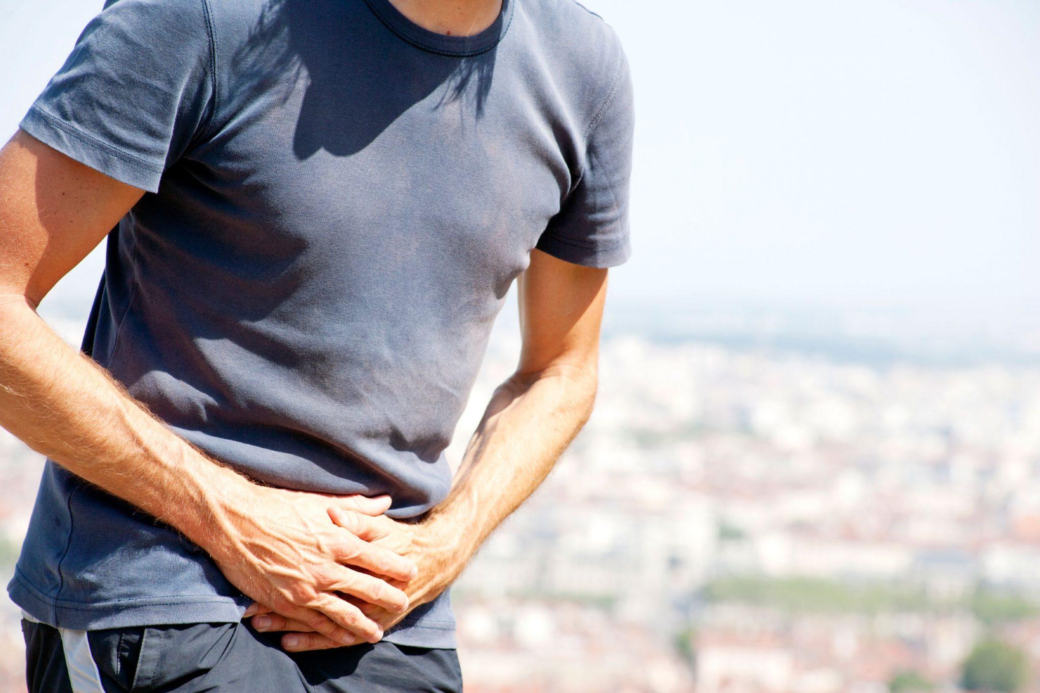 Guy holding stomach